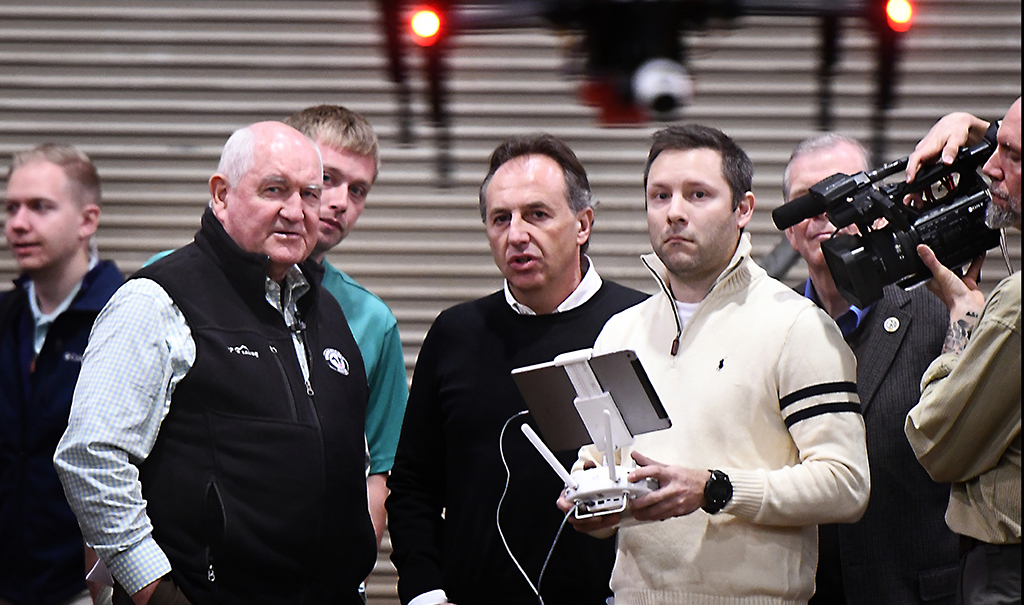 Perdue, Basso and Price watch the drone fly